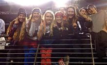Fans at a high school football game (my friends and I) Source: my photo