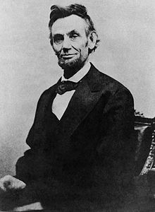 220px-Abraham_Lincoln_half_length_seated,_April_10,_1865