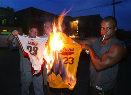 Fans burn James' jersey after he announces he is going to Miami.