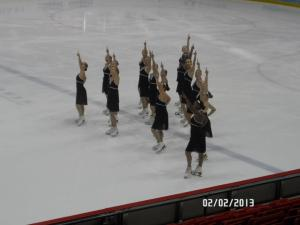 A photo of my old skating team at a competition on the same rink where the 1980 Miracle on Ice occurred.