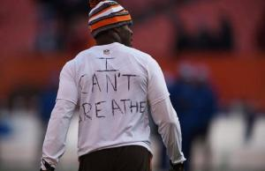 Johnson Bademosi #24 of the Cleveland Browns displays a message protesting the death of Eric Gardner