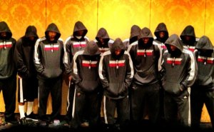 Lebron James and the Miami Heat wearing hoods with their heads bowed in support of Trayvon Martin